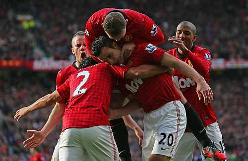 Manchester United players celebrate after scoring