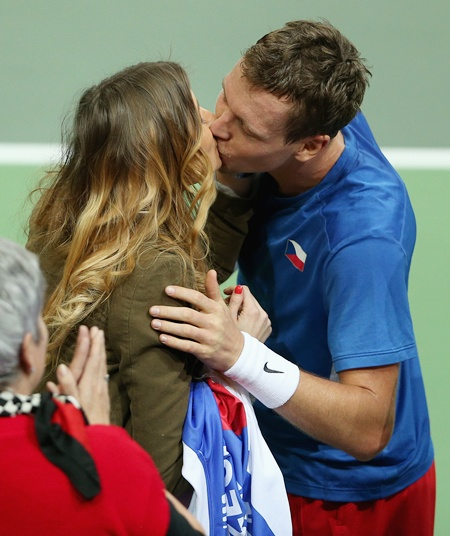 Tomas Berdych of Czech Republic kisses his girlfriend Ester Satorova