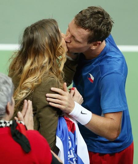 Tomas Berdych of Czech Republic kisses his girlfriend Ester Satorova