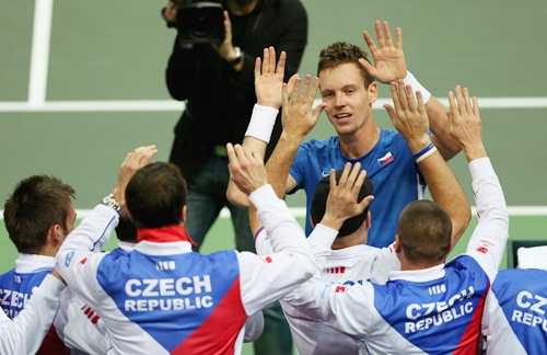 Tomas Berdych of Czech Republic is congratulated by his team mates