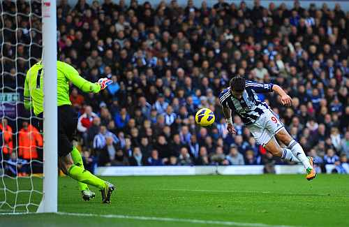 Shane Long of West Brom scores to make it 1-0 during the Barclays Premier League match between West Bromwich Albion and Chelsea