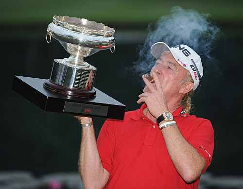 Miguel Angel Jimenez of Spain with the winners trophy and his cigar after the final round of the UBS Hong Kong open at The Hong Kong Golf Club