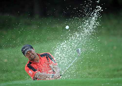 Michael Campbell of New Zealand plays a bunker shot during the final round of the UBS Hong Kong open