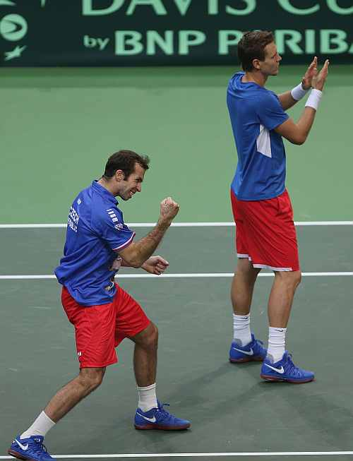 Radek Stepanek and Tomas Berdych of Czech Republic celebrate victory in four sets in their doubles match against Marc Lopez and Marcel Granollers of Spain