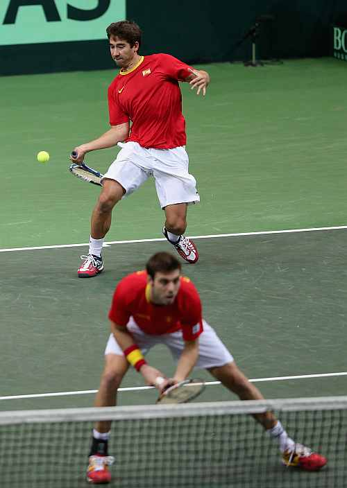 Marc Lopez and Marcel Granollers of Spain in action during their doubles match against Radek Stepanek and Tomas Berdych of Czech Republic