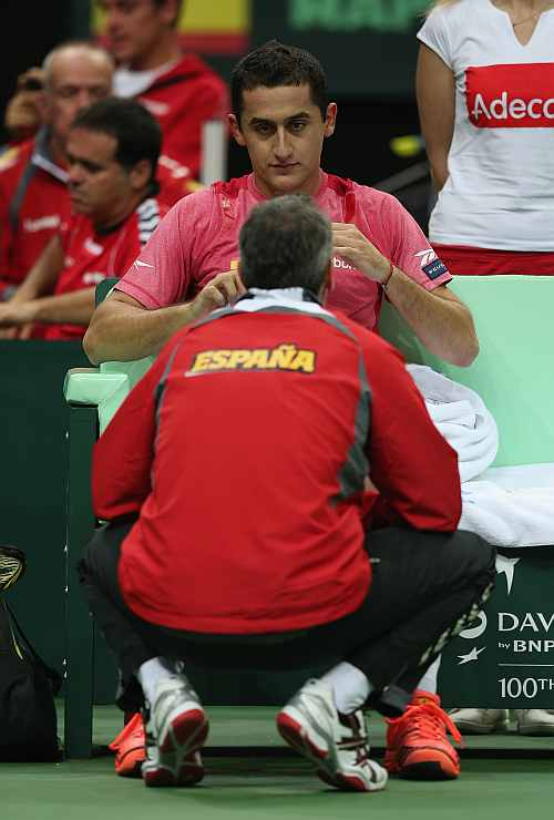 Nicolas Almagro of Spain listens to his team captain Alex Corretja during his match against Tomas Berdych of Czech Republic