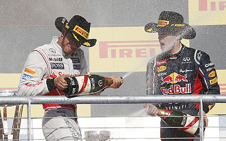 McLaren's Lewis Hamilton (left) and Red Bull's Sebastian Vettel spray champagne during the podium ceremony after the US Grand Prix at the Circuit of the Americas in Austin, Texas on Sunday