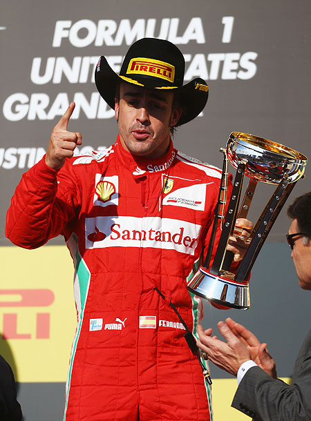 Fernando Alonso of Ferrari celebrates on the podium after finishing third at the US Grand Prix at the Circuit of the Americas on Sunday