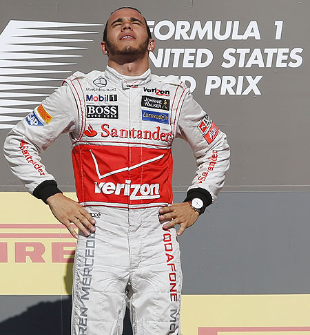 Lewis Hamilton on the podium after winning the US Grand Prix