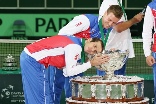 Tomas Berdych of the Czech Republic laughs at his team mate Radek Stepanek