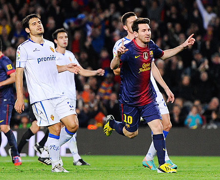 Barca's Lionel Messi celebrates after scoring against Real Zaragoza on Saturday