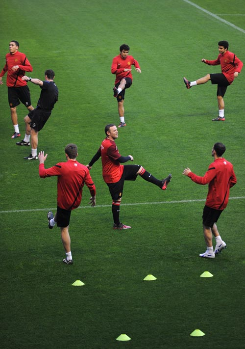 Manchester United players warm-up before a match