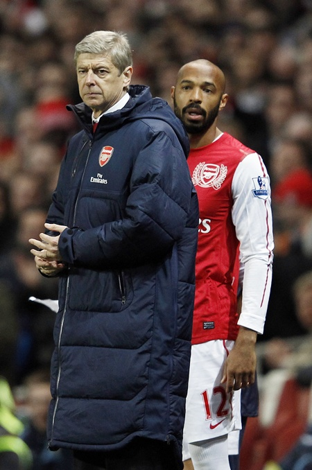 Thierry Henry looks on beside manager Arsene Wenger