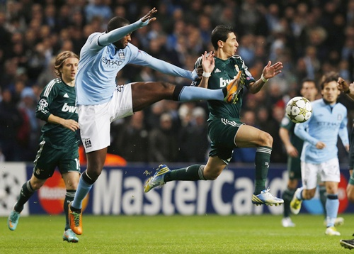 Manchester City's Yaya Toure (left) is challenged by Real Madrid's Angel Di Maria