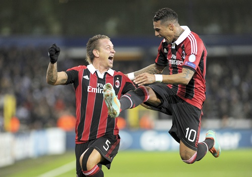 AC Milan's Philippe Mexes celebrate his goal with Kevin-Prince Boateng