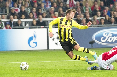 Borussia Dortmund's Mario Goetze fights for the ball with Ajax Amsterdam's Niklas Moisander