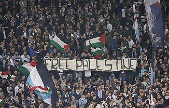 SS Lazio's fans display a banner that reads, Free Palestine during the Europa League soccer match against Tottenham at the Olympic stadium in Rome on Thursday