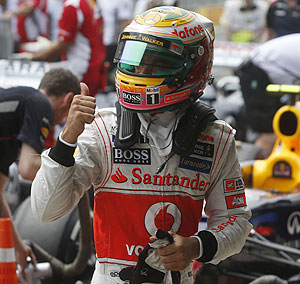 McLaren Formula One driver Lewis Hamilton celebrates after taking the pole position during qualifying at the Brazilian GP