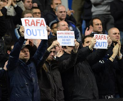 Chelsea fans hold up signs during their English Premier League soccer match against Manchester City