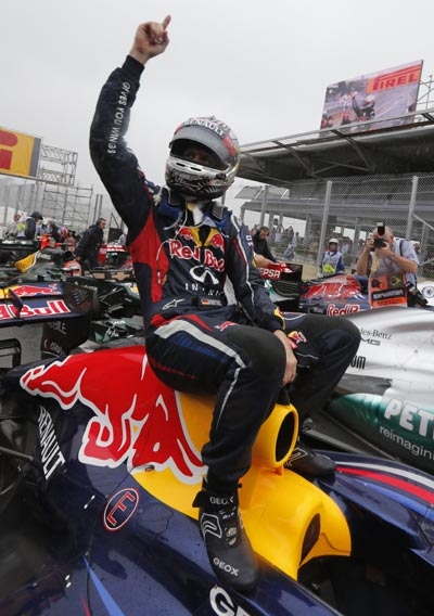Red Bull Formula One driver Sebastian Vettel of Germany celebrates winning the world championship after finishing sixth in the Brazilian F1 GP