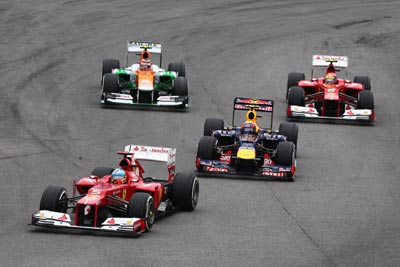 Fernando Alonso of Spain and Ferrari leads from Mark Webber of Australia during Brazil GP
