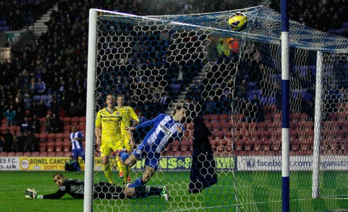 Jordi Gomez of Wigan scores his first goal during the Barclays Premier League match between Wigan Athletic and Reading