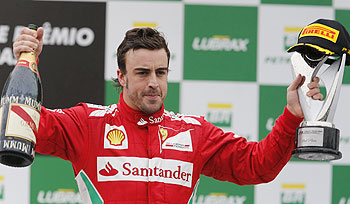 Second placed Ferrari's Fernando Alonso celebrates after the Brazilian F1 Grand Prix at Interlagos circuit in Sao Paulo on Sunday