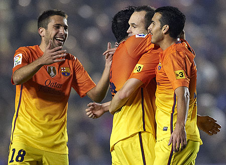 Barcelona's Andres Iniesta celebrates with teammate Pedro Rodriguez (right), Jordi Alba (left) and Xavi Hernandez after scoring against Levante on Sunday