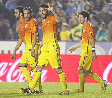 Barcelona's Cesc Fabregas (centre) celebrates with teammates after he scoring against Levante on Sunday