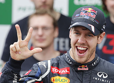 Red Bull Formula One driver Sebastian Vettel celebrates winning the world championship with his team after the Brazilian F1 Grand Prix on Sunday
