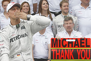 Mercedes Formula One driver Michael Schumacher gestures during a photo call before the Brazilian F1 Grand Prix  on Sunday
