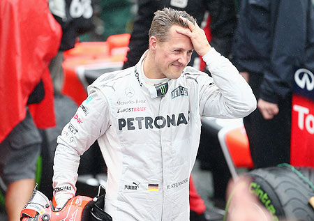 Michael Schumacher of Mercedes GP reacts in parc ferme after finishing his last F1 race following the Brazilian Formula One Grand Prix on Sunday
