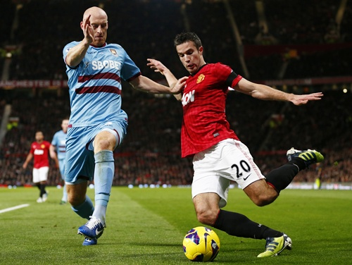 West Ham United's James Collins challenges Manchester United's Robin van Persie