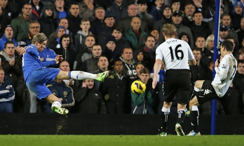 Chelsea's Torres (left) volleys a shot at goal against Fulham