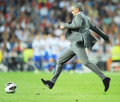 Head coach Jose Mourinho of Real Madrid kicks the ball
