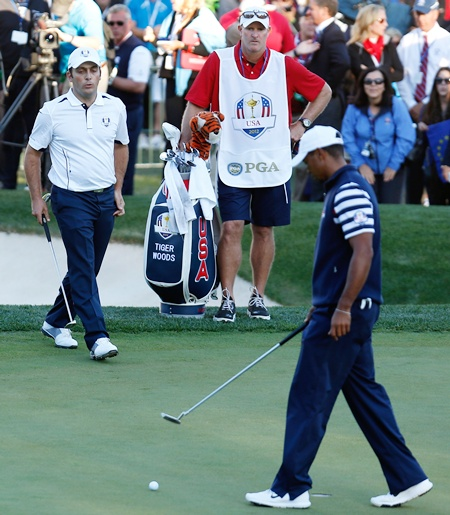 Francesco Molinari of Europe looks on as Tiger Woods of the USA misses his par putt