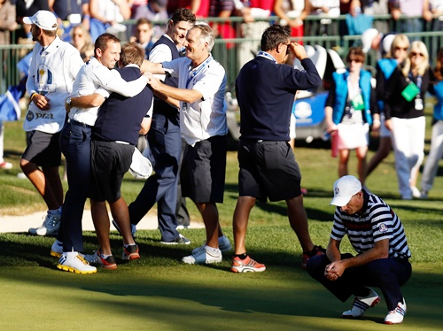 Jim Furyk of the USA (right) reacts to a missed par putt on the 18th green as Sergio   Garcia and the European team celebrate