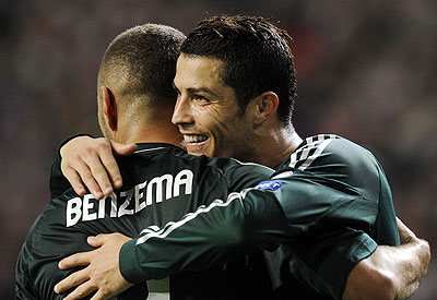Real Madrid's Cristiano Ronaldo (right) and Karim Benzema celebrate a goal during their Champions League match against Ajax Amsterdam on Wednesday