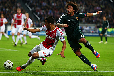 Ricardo Van Rhijn of Ajax and Marcelo of Real battle for the ball during their Champions League match on Wednesday