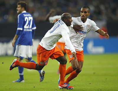 Montpellier HSC's Souleymane Camara and Joris Marveaux (right) celebrate a goal against Schalke 04 during the Champions League match on Wednesday