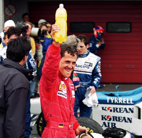 Ferrari driver Michael Schumacher celebrates after the European GP at the Nurburgring, in Nurburg, Germany on April 28, 1996