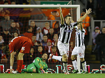 Udinese's Giovanni Pasquale (2nd from right) celebrates scoring against Liverpool during their Europa League match on Thursday