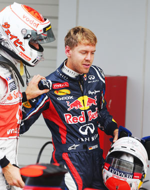 Pole sitter Sebastian Vettel (right) with Jenson Button