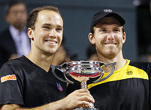 Alexander Peya (right) of Austria and Bruno Soares of Brazil pose with their trophy after winning the men's doubles finals match against Leander Paes of India and Radek Stepanek of the Czech Republic at the Japan Open on Sunday