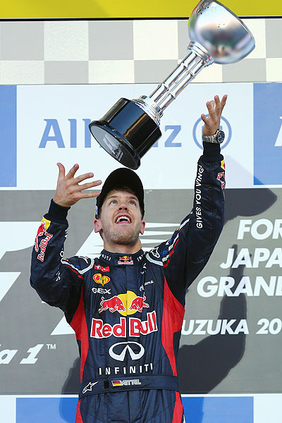 Red Bull Racing's Sebastian Vettelcelebrates on the podium after winning the Japanese GP on Sunday