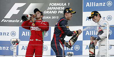 Ferrari's Felipe Massa (left), Red Bull's Sebastian Vettel (centre) and Sauber's Kamui Kobayashi on the podium on Sunday