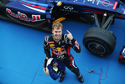 Red Bull's Sebastian Vettel celebrates in parc ferme after winning the Japanese Formula One Grand Prix on Sunday
