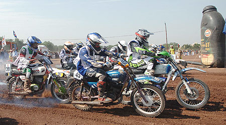Riders pass the starting line at the start of a race at the Gulf Cup Dirt Track National Championship