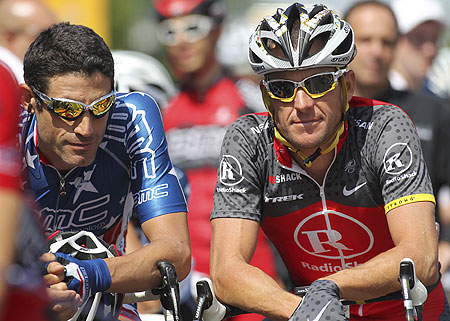 Lance Armstrong (right) is pictured with former teammate George Hincapie