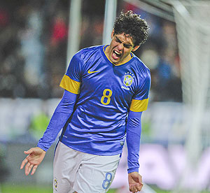 Brazil's Kaka celebrates scoring his team's third goal against Iraq on Thursday